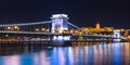 Night view of the Chain Bridge Lions Bridge reflected in the Danube river, Budapest city center, Hungary Royalty Free Stock Photo