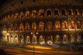 Night view coliseum in rome italy the by at twilight one of the most known landmark of Royalty Free Stock Photo