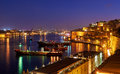 The night view of Grand Harbour with the cargo ships moored near Royalty Free Stock Photo