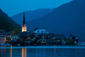 Night view of hallstatt village with christuskirche church bell tower austria Royalty Free Stock Photo