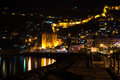 Night view of harbour, fortress and ancient shipyard in Alanya, Turkey. Royalty Free Stock Photo