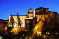 Night view of medieval houses on rocks rocky river bank jucar in cuenca castilla la mancha spain Stock Photography