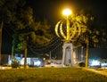 Night view Monument emblem of Iran, word Allah, Yazd, Iran