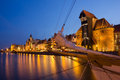 Night view over the river motlawa the old town with sailing ship in foreground in gdansk poland Royalty Free Stock Photography