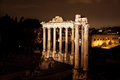 Night view of roman forum temple saturn in rome italy Stock Image