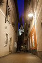 Night view of a street with christuskirche church bell tower in hallstatt austria Stock Images