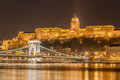 Night view of the Szechenyi Chain Bridge over Danube River and Royal Palace in Budapest, Royalty Free Stock Photo