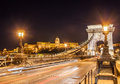 Night view of the Szechenyi Chain Bridge over Danube River and Royal Palace in Budapest Royalty Free Stock Photo