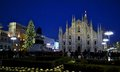 Night view to duomo tall illuminated christmas tree and people walking milan italy – december the square decorated with a Royalty Free Stock Photos