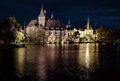 Night view of Vajdahunyad castle from lakeside
