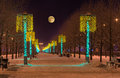 Night winter landscape in the alley of city park Royalty Free Stock Photo