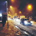 Night winter street city with cars and people in heavy snowfall Royalty Free Stock Photography
