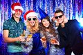 Nightclub group of cheerful young people celebrating christmas at the Royalty Free Stock Image