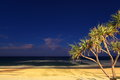 Nightfall at tropical beach a typical atmospheric picture night sky with calm sea and lit Royalty Free Stock Photography