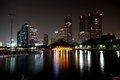 Nightlife buildings of bangkok the reflective surface of the water in benjakiti queen sirikit convention center Stock Image