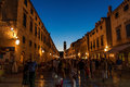 Nightlife in dubrovnik old town busy pedestrian placa street croatia photographed at dusk with clock tower the background Stock Photos