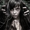 Nightmare and halloween theme portrait of scary girl witch in the woods Royalty Free Stock Photography