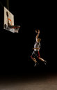 Nighttime basketball player Royalty Free Stock Image
