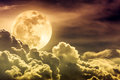 Nighttime sky with clouds and bright full moon with shiny. Royalty Free Stock Photo