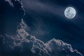 Nighttime sky with clouds bright full moon would make a great b attractive photo of background nightly large Royalty Free Stock Image