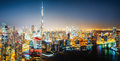 Nightttime skyline of a big futuristic city by night. Business bay, Dubai, United Arab Emirates. Royalty Free Stock Photo