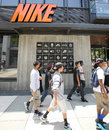 Nike shoes clothing and accessories santa monica california tues june shoppers walk past a sports store in santa monica california Stock Image