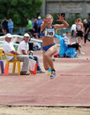 Nikolaeva Irina competes in the triple jump Stock Images