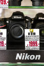 Nikon cameras in a german shopping window focus is on the logo on the bottom Royalty Free Stock Images