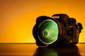 Nikon d with sigma mm f ex dg hsm lens digital slr camera product shot on yellow background is a multination corporation Stock Photo