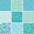 Nine baby boy blue seamless patterns backgrounds vector set with hand drawn elements Stock Photography