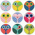 Nine funny owl faces in a circle set of colored placed circles and isolated on white background cartoon vector illustration as Stock Photos