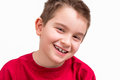 Nine years old looking trustfully yoears boy at camera with his toothy smile Stock Image