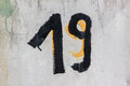 Nineteen number grunge viev of the painted on the steel door Stock Image