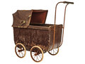 Nineteenth century baby pram isolated on white brown a background Stock Photo