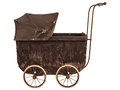Nineteenth century baby pram isolated on white side view of a brown a background Royalty Free Stock Images