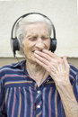 Ninety years old woman reaction to modern music grandma listeni while listening listening on headphones Stock Photography