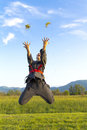 Ninja girl throwing grass Royalty Free Stock Photography