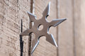 Ninja star silver embedded in wall Stock Photos