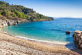 Nissaki beach tranguil a small cove lapped by limpid waters on the north east coast of corfu greece Royalty Free Stock Photos