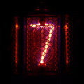 Nixie tube indicator of the numbers retro style. Digit 7 Royalty Free Stock Photo