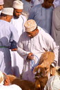 NIZWA, OMAN - FEBRUARY 3, 2012: Omani men traditionally dressed attending the Goat Market in Nizwa