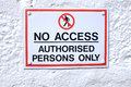 No access sign a with a white background and red rectangle with the words authorised persons only written in black and the symbol Royalty Free Stock Photos
