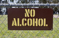 NO ALCOHOL Sign Attached to Park Fence Royalty Free Stock Photo