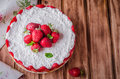 No baked Strawberry Cheesecake with cottage cheese on wooden background, selective focus. Royalty Free Stock Photo