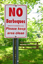 No barbeques sign in a public park north america with bench and table behind Royalty Free Stock Photography
