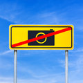 No camera sign on a yellow roadsign against blue sky Royalty Free Stock Photo