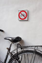 No cycling sign and bicycle leaning against wall of building with Royalty Free Stock Photos