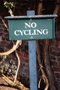 No cycling sign green wooden Stock Photography
