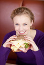 No diet woman holding very big sandwich in her hand Royalty Free Stock Images