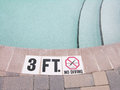 No diving shallow area of a pool sign Royalty Free Stock Photo